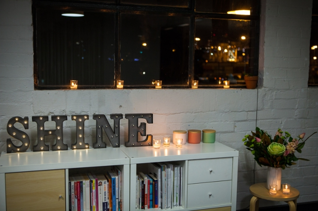 Shine lettering networking night flowers candles