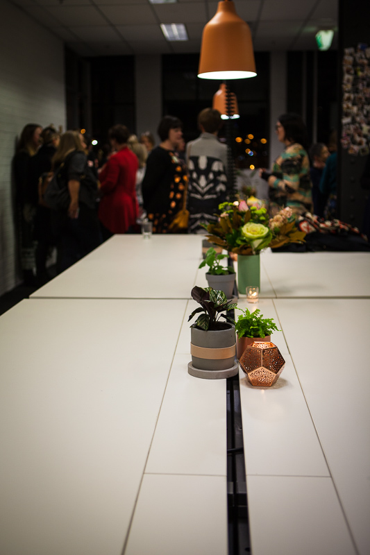 table flowers candles networking people