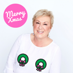Breast cancer survivor, Nellie owner of FOC Box wearing wreaths over her breasts
